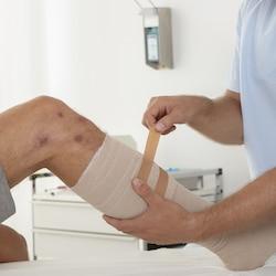 Fixation of bandage with Leukoplast tape