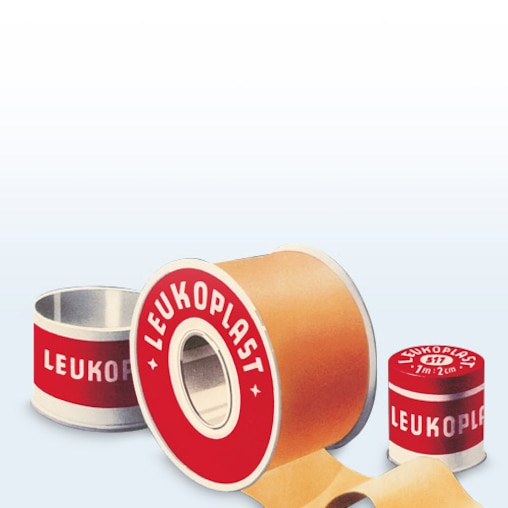Three pieces of the historic Leukoplast spool, the first self-adhesive fixation tape.