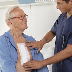 Hypafix skin sensitive by Leukoplast, close-up view plaster on chest of elderly man