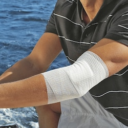Fixation of dressing with Easifix K by Leukoplast on arm
