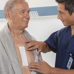 Inspection of Leukomed T plus skin sensitive by Leukoplast  dressing on chest