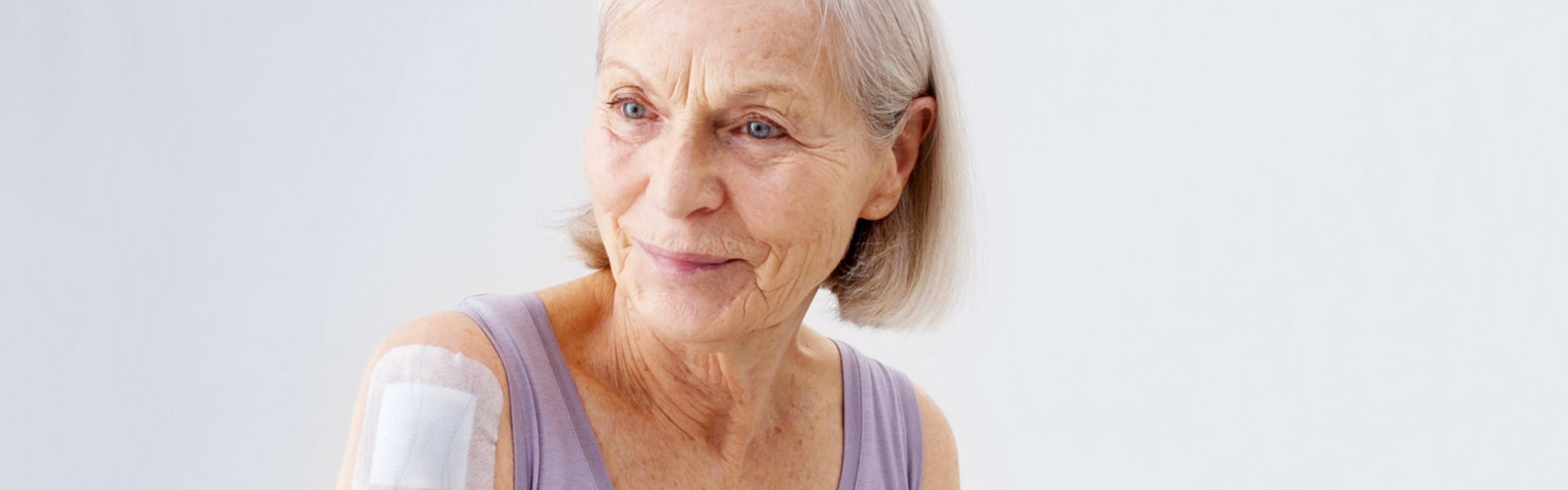 Almost pain-free and atraumatic dressing removal from an elderly woman's fragile skin.